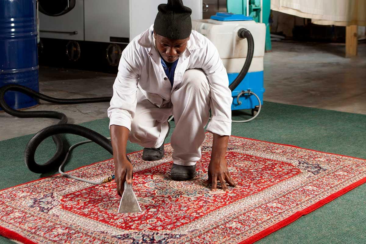 vacuuming a persian rug