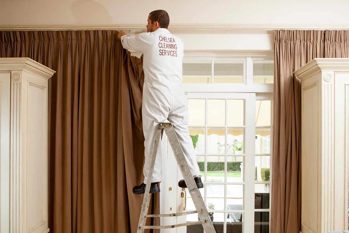 hanging up clean curtains