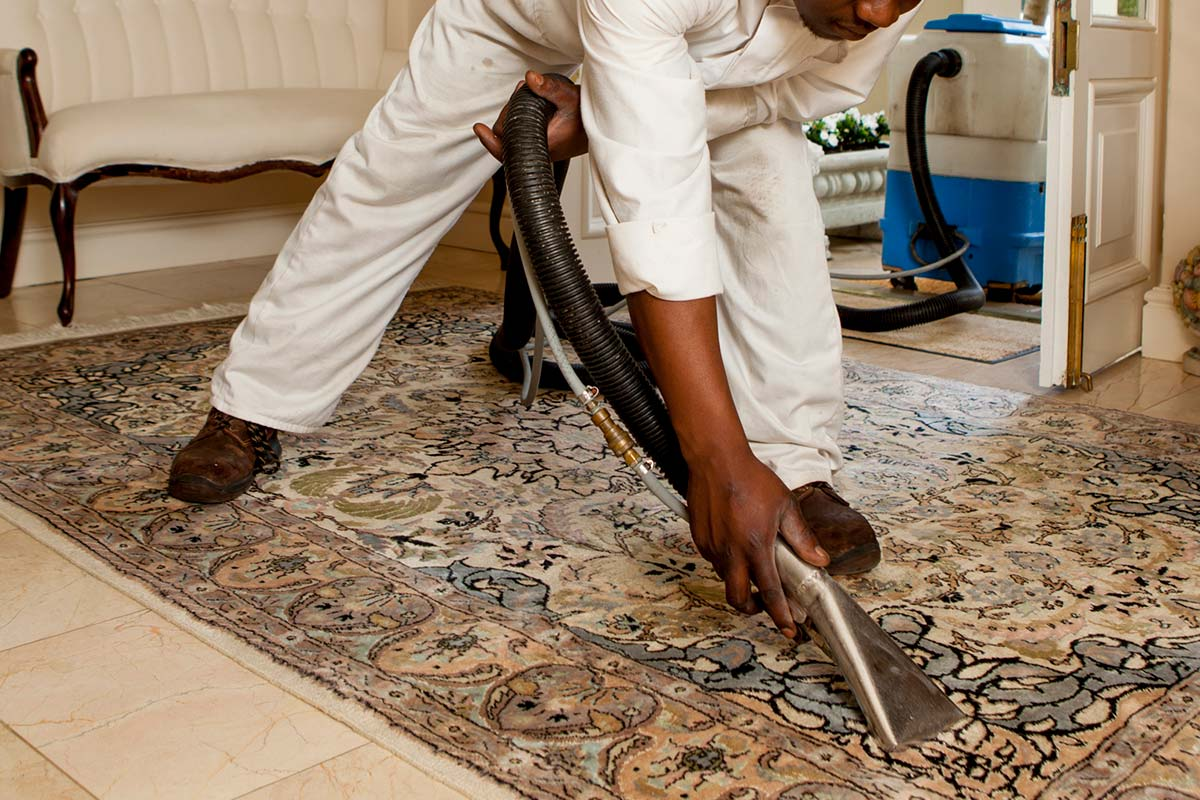 vacuuming loose rugs